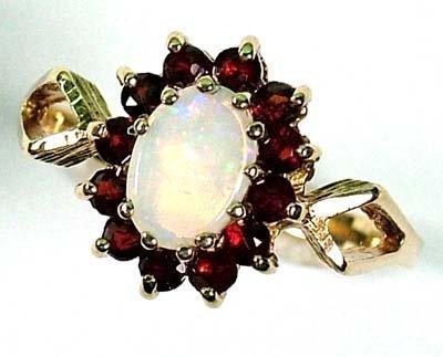 20: Ladies' opal and garnet ring