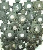 937: Police helmet plates (24)
