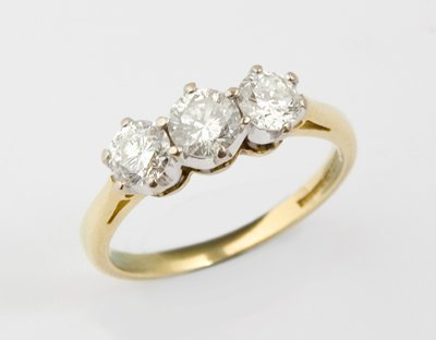 3: Ladies three stone diamond ring