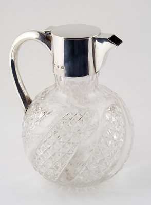 397: Cut glass silver topped claret jug