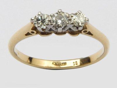 12: Ladies three stone diamond ring