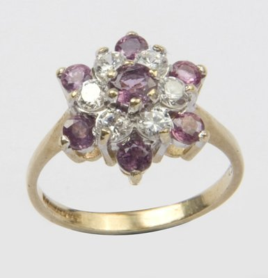 20: Ladies ruby and CZ cluster ring