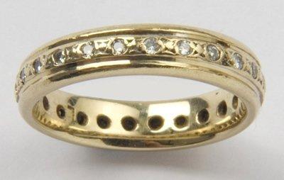 24: Ladies diamond set eternity ring