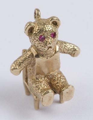 11: Teddy bear on chair charm