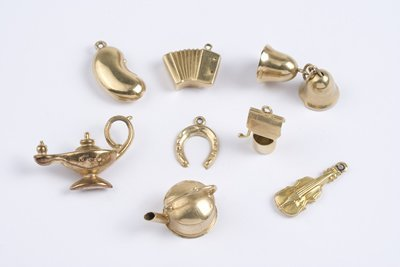 24: Misc. hollow gold charms (8)