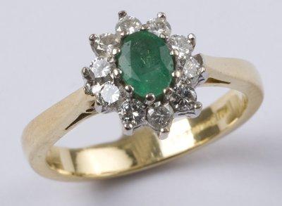 7: Ladies' emerald & diamond cluster ring