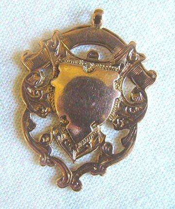 13: Antique fob shield