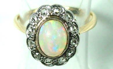766: Ladies' opal and diamond ring