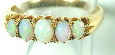 767: Ladies' five stone opal ring