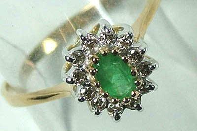 776: Ladies' emerald and diamond cluster ring