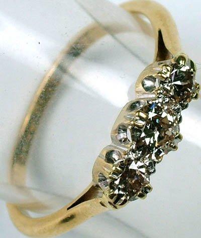5: Ladies three stone diamond ring