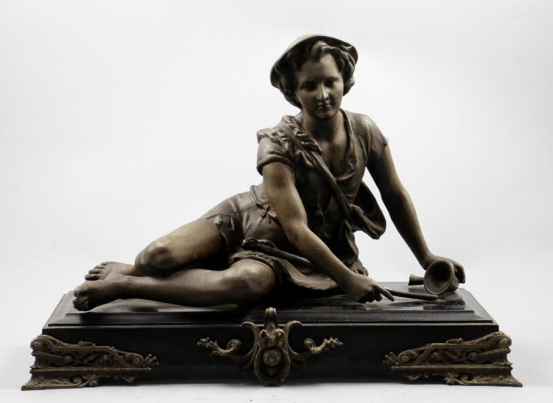 CAST SPELTER FIGURE OF A YOUNG BOY RESTING WITH A CANE