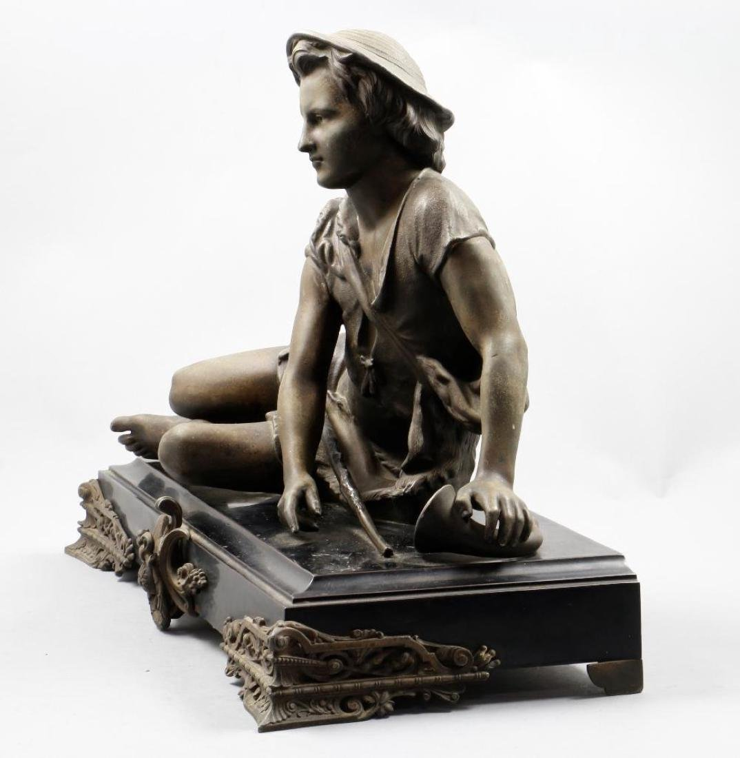 CAST SPELTER FIGURE OF A YOUNG BOY RESTING WITH A CANE - 2
