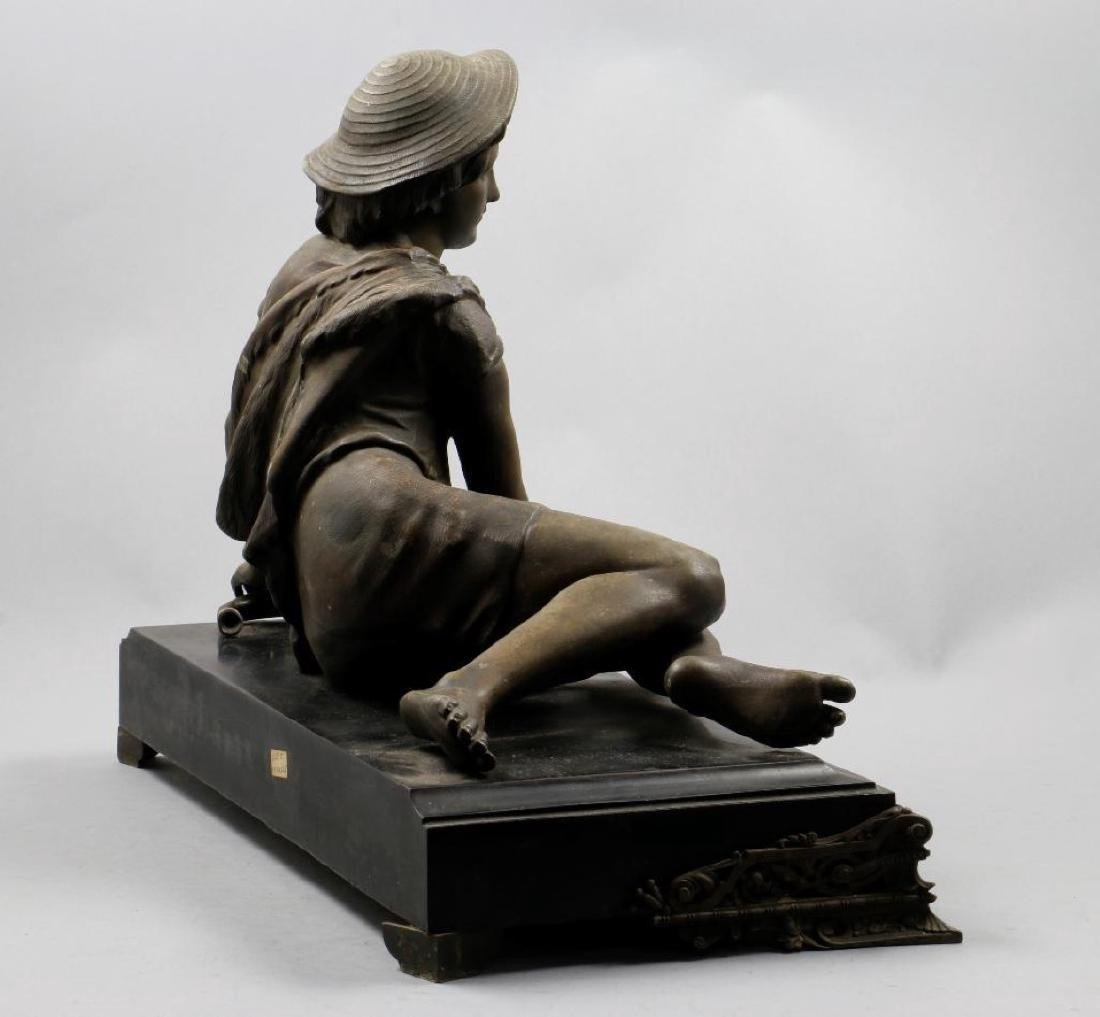 CAST SPELTER FIGURE OF A YOUNG BOY RESTING WITH A CANE - 4