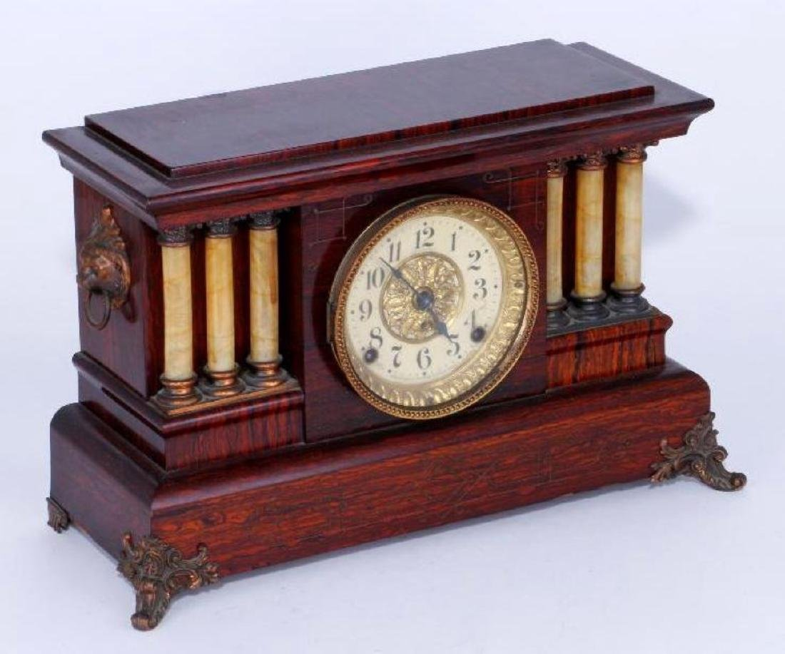 A SETH THOMAS FAUX ROSEWOOD SHELF CLOCK, LATE 19TH C.