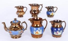 FIVE COPPER LUSTRE PITCHERS,AND A TEAPOT, 19THC.