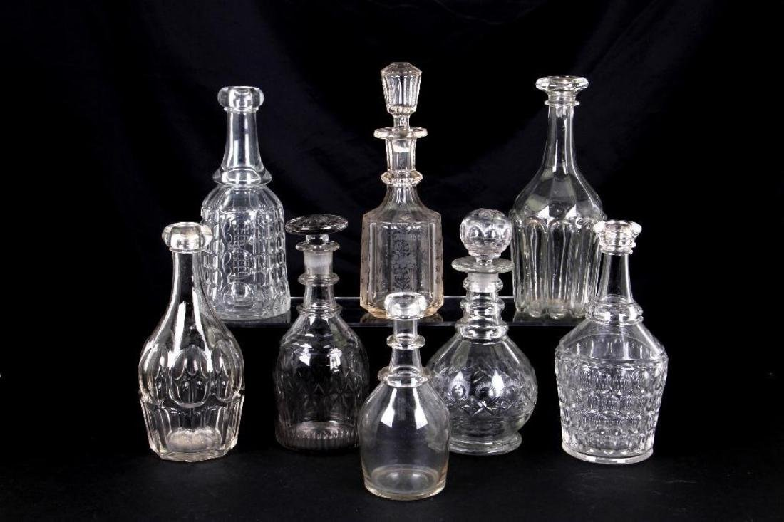 8 MOLD AND CUT GLASS BAR BOTTLES AND DECANTERS, 19THC.