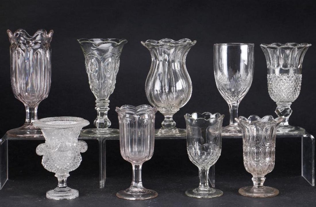 EIGHT MOLDED GLASS VASES, 19TH CENTURY