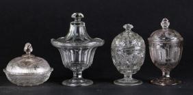 FOUR MOLDED GLASS LIDDED BOWLS, 19THC.