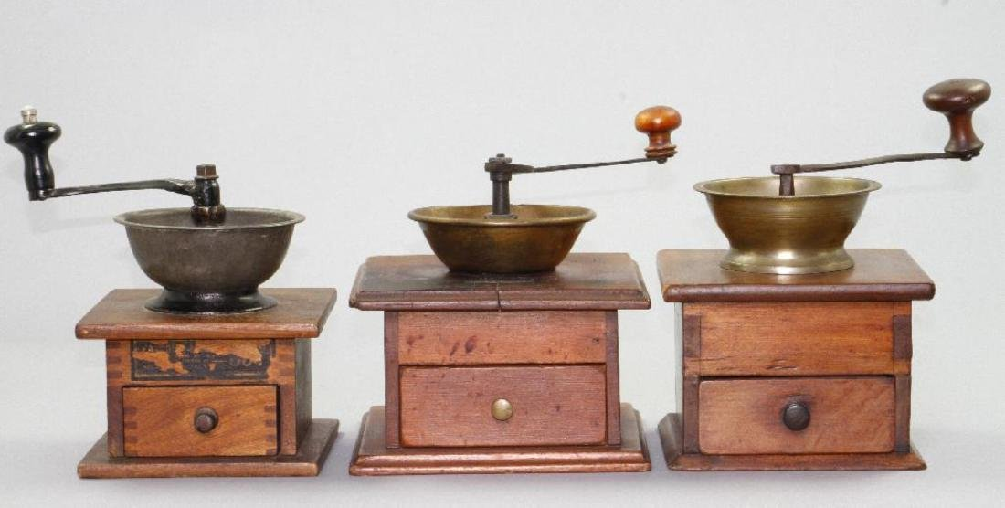 3 CAST IRON , BRASS, AND WOOD, COFFEE GRINDERS, 19THC.