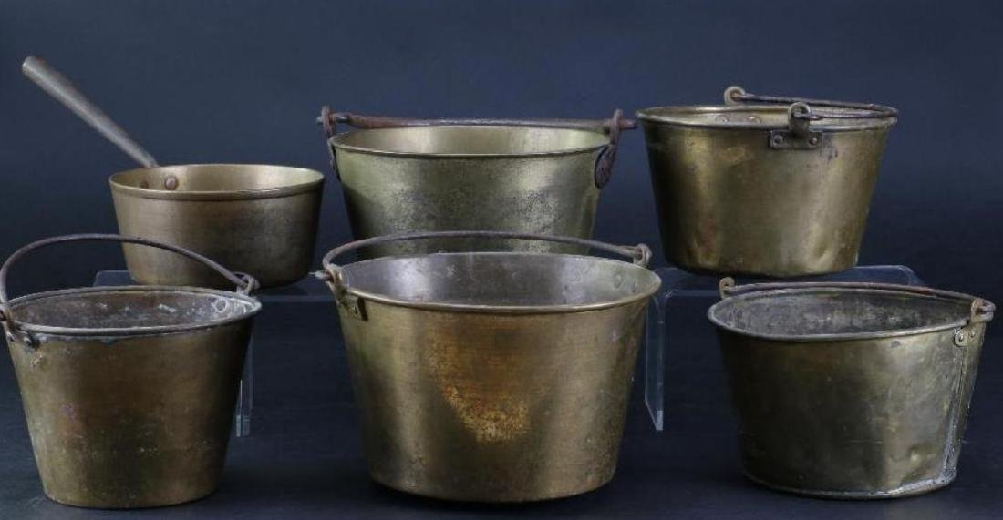 FIVE BRASS PAILS, TOGETHER WITH A HANDLED PAN