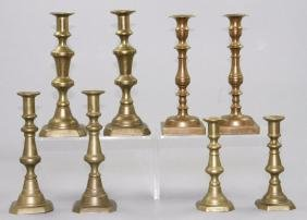 FOUR PAIR OF BRASS AND BELL METAL CANDLESTICK