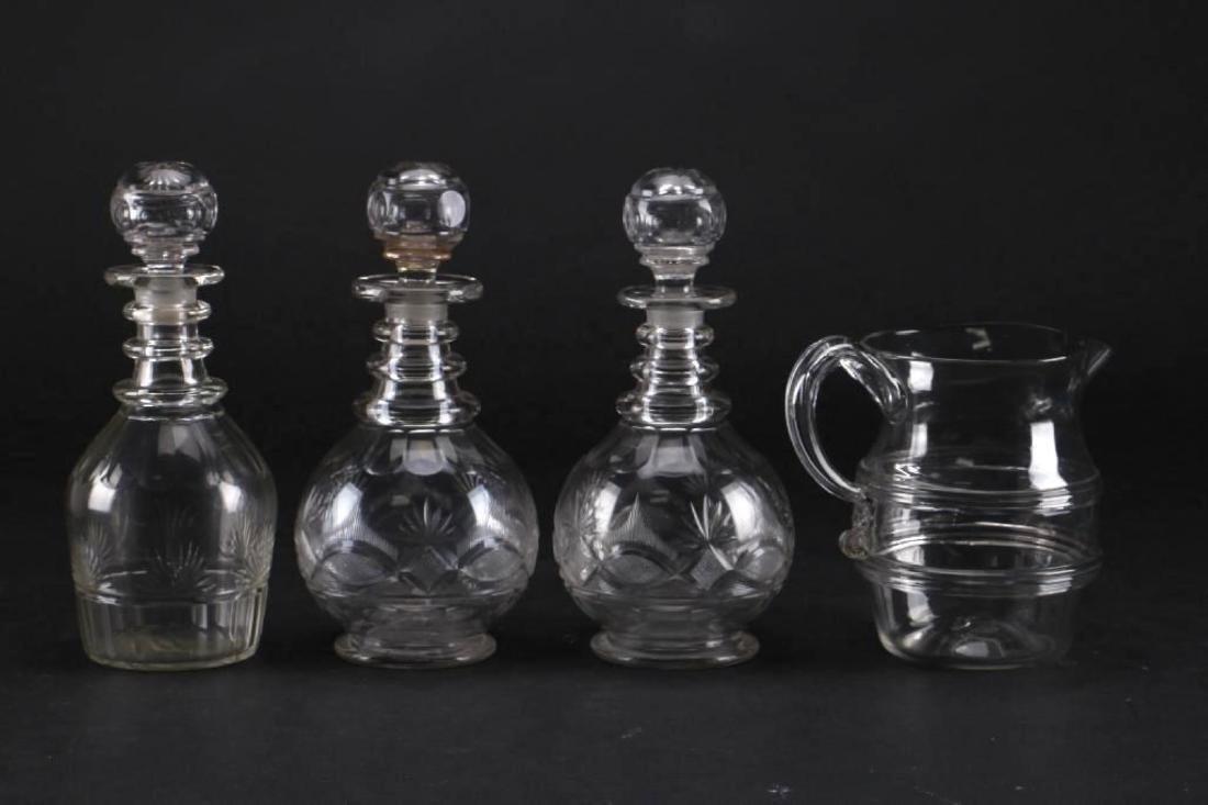 3 CUT GLASS DECANTER & A BLOWN GLASS PITCHER - 3