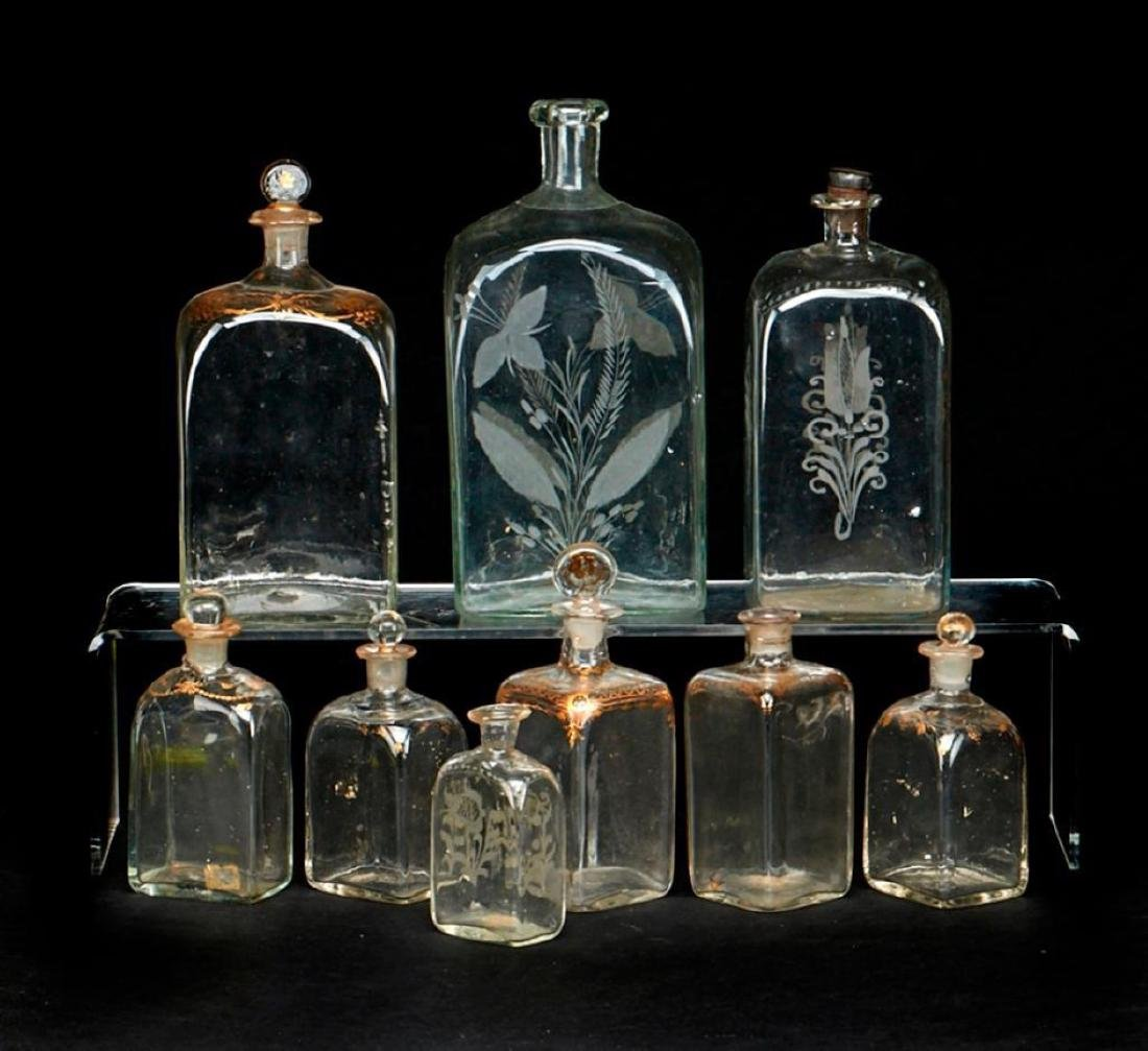 9 DUTCH GILT OR ENGRAVED GLASS DECANTERS