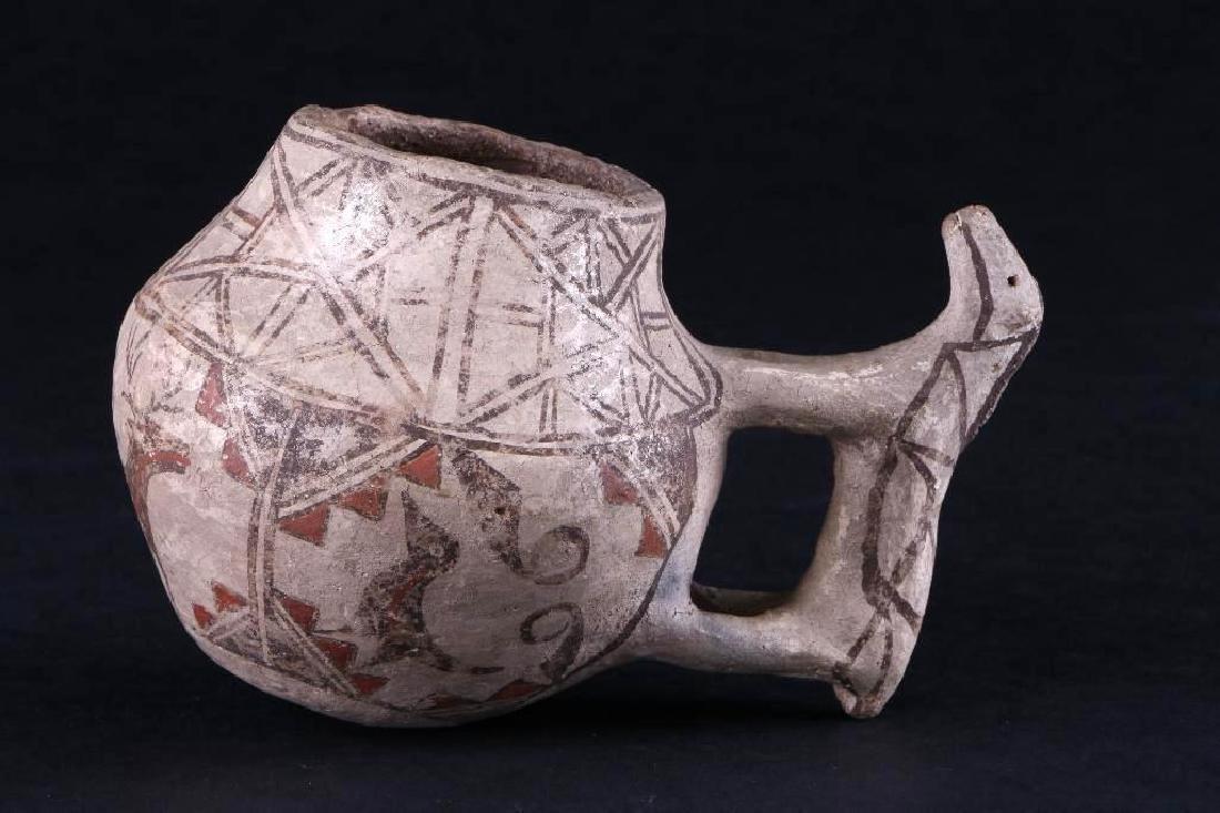 Unusual Zuni polychrome pottery effigy jar