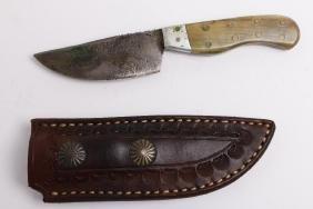 Hand-tooled leather knife sheath and knife