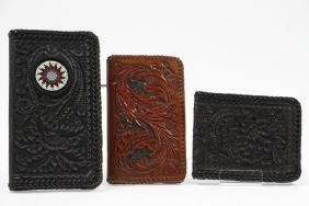 Three hand-tooled leather accessories