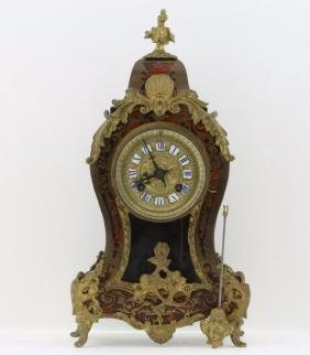 A LOUIS XV STYLE GILT BRONZE BOULLE MARQUETRY CLOCK