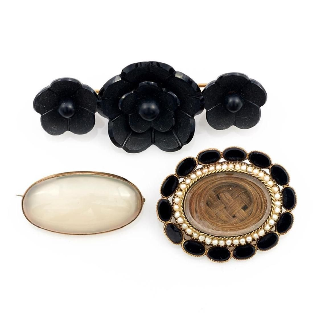 Three Victorian gem-set and 10k gold brooches