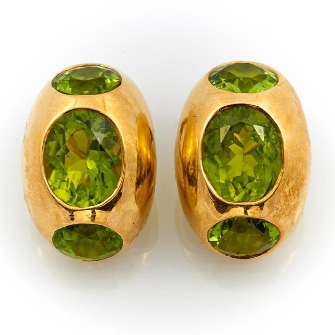 Pair of peridot and 18k gold clip earrings, Gumps