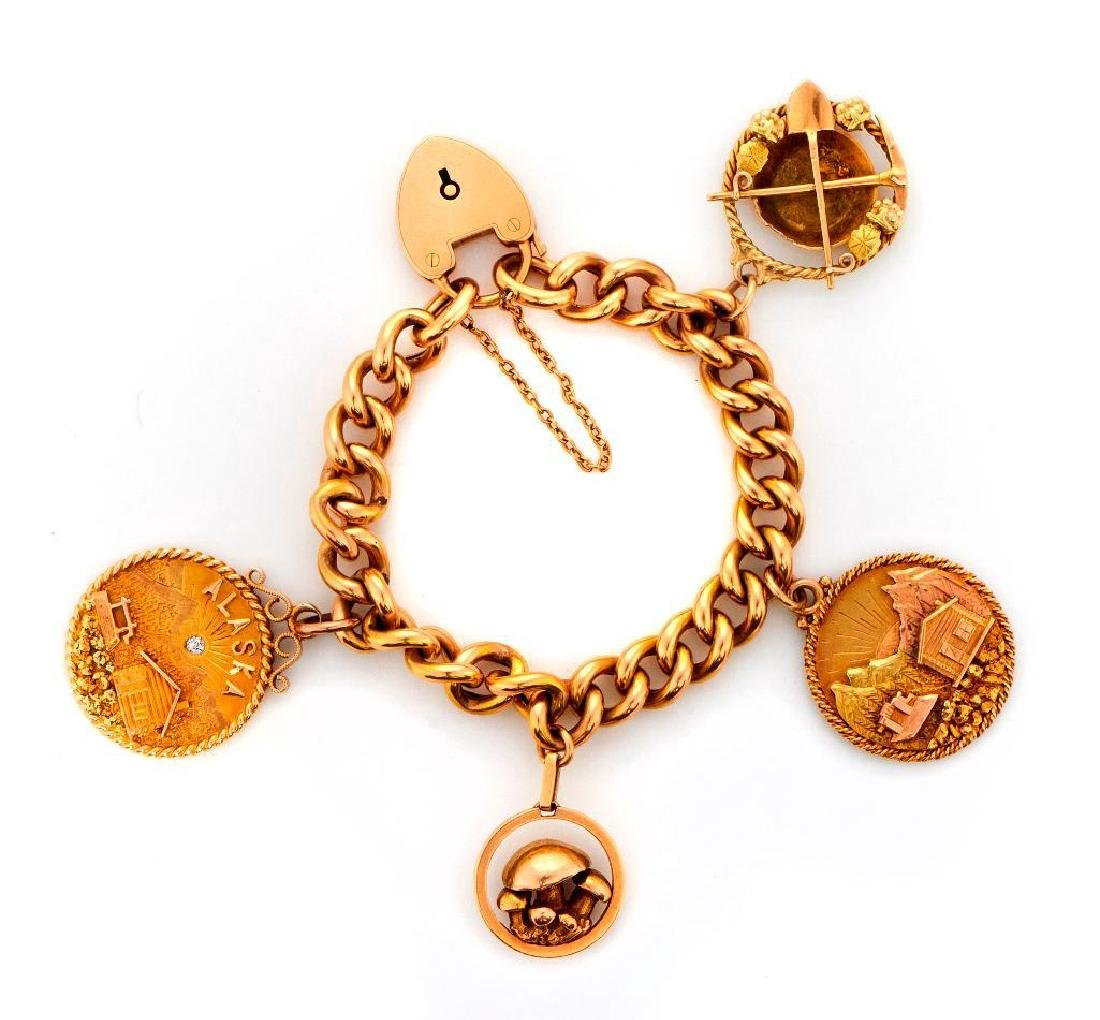 14k gold gold rush motif charm bracelet