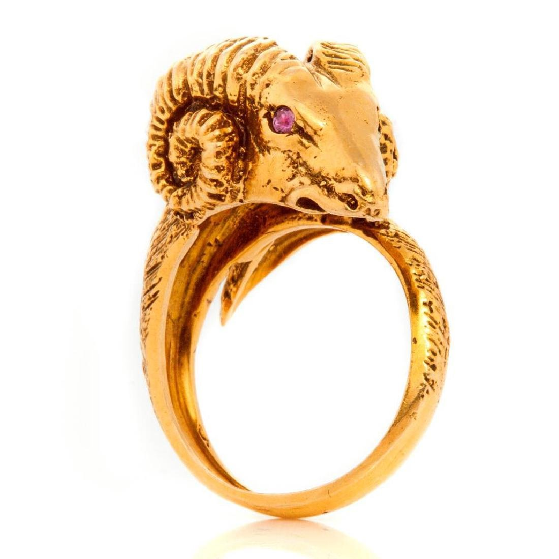 14k gold ram's head ring with ruby eyes