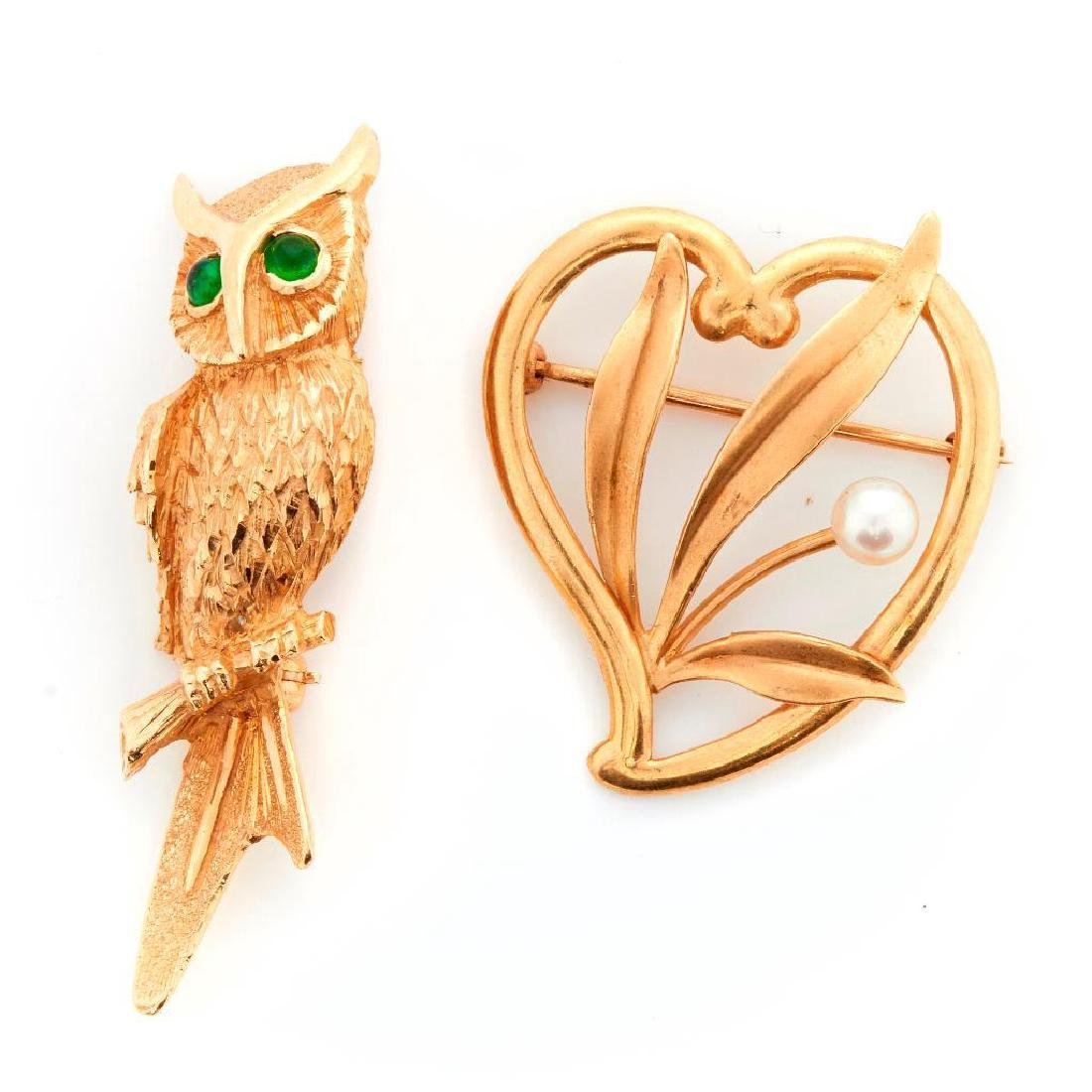Two 14k gold brooches
