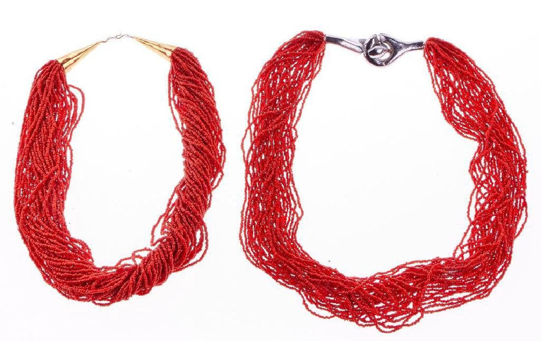 Two multi-strand coral bead necklaces