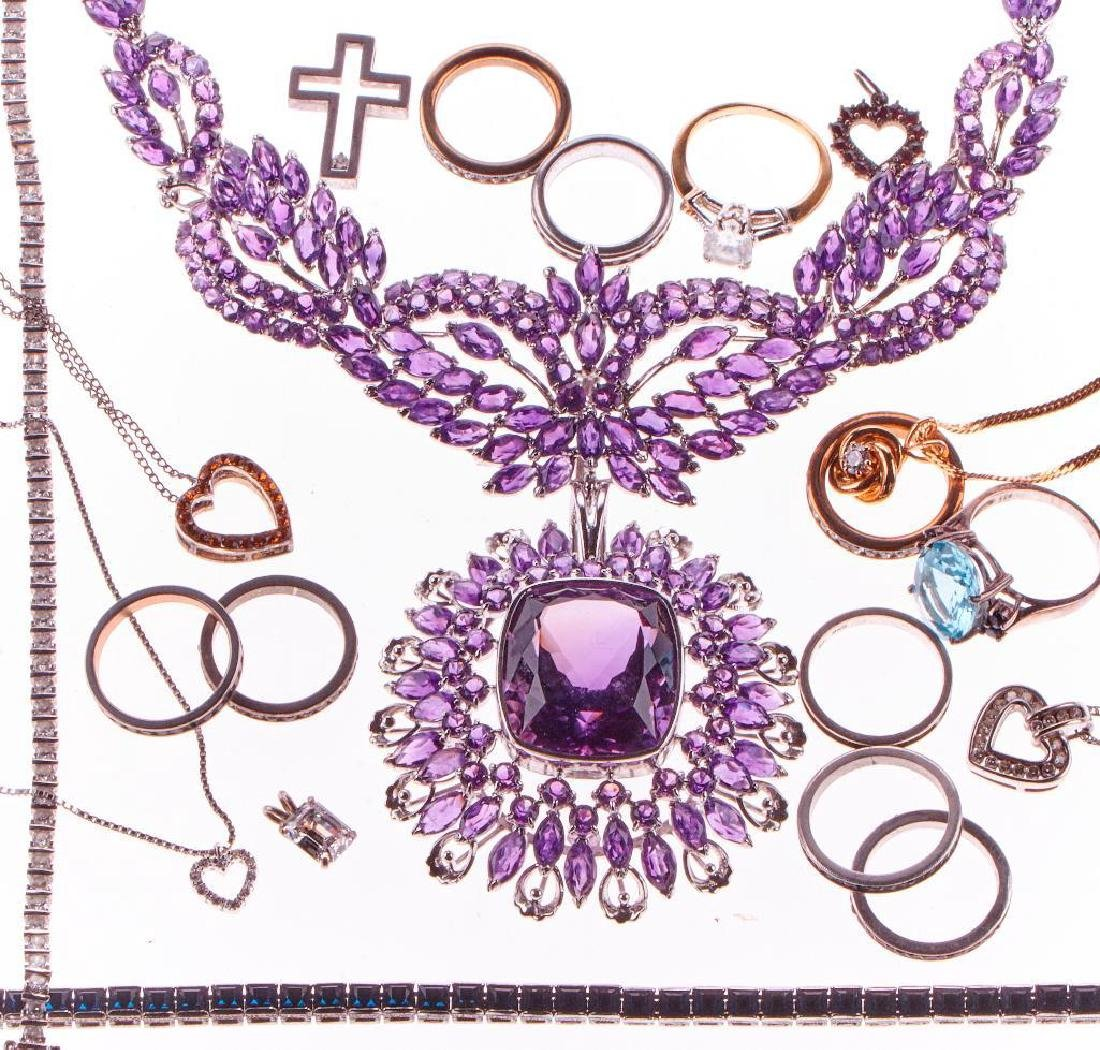 Collection of rhinestone and silver jewelry