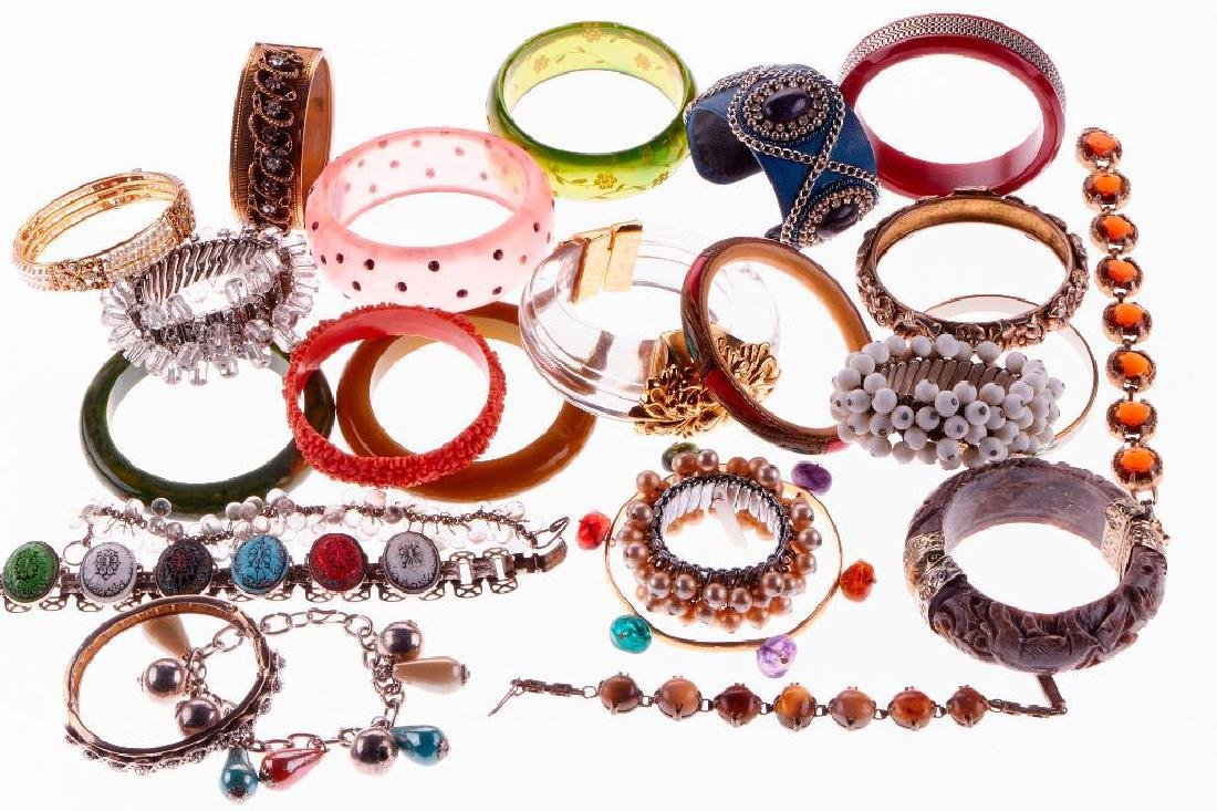 Collection of 24 silver, stone and costume bracelets