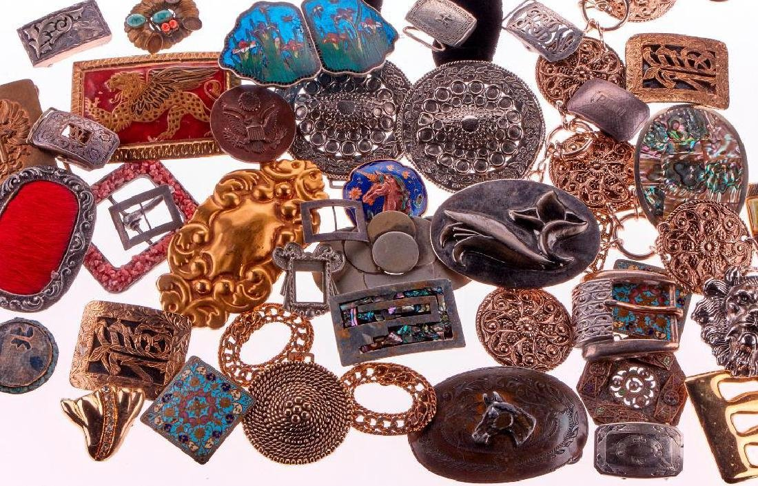 Collection of 50+ silver, metal belt buckles and belt