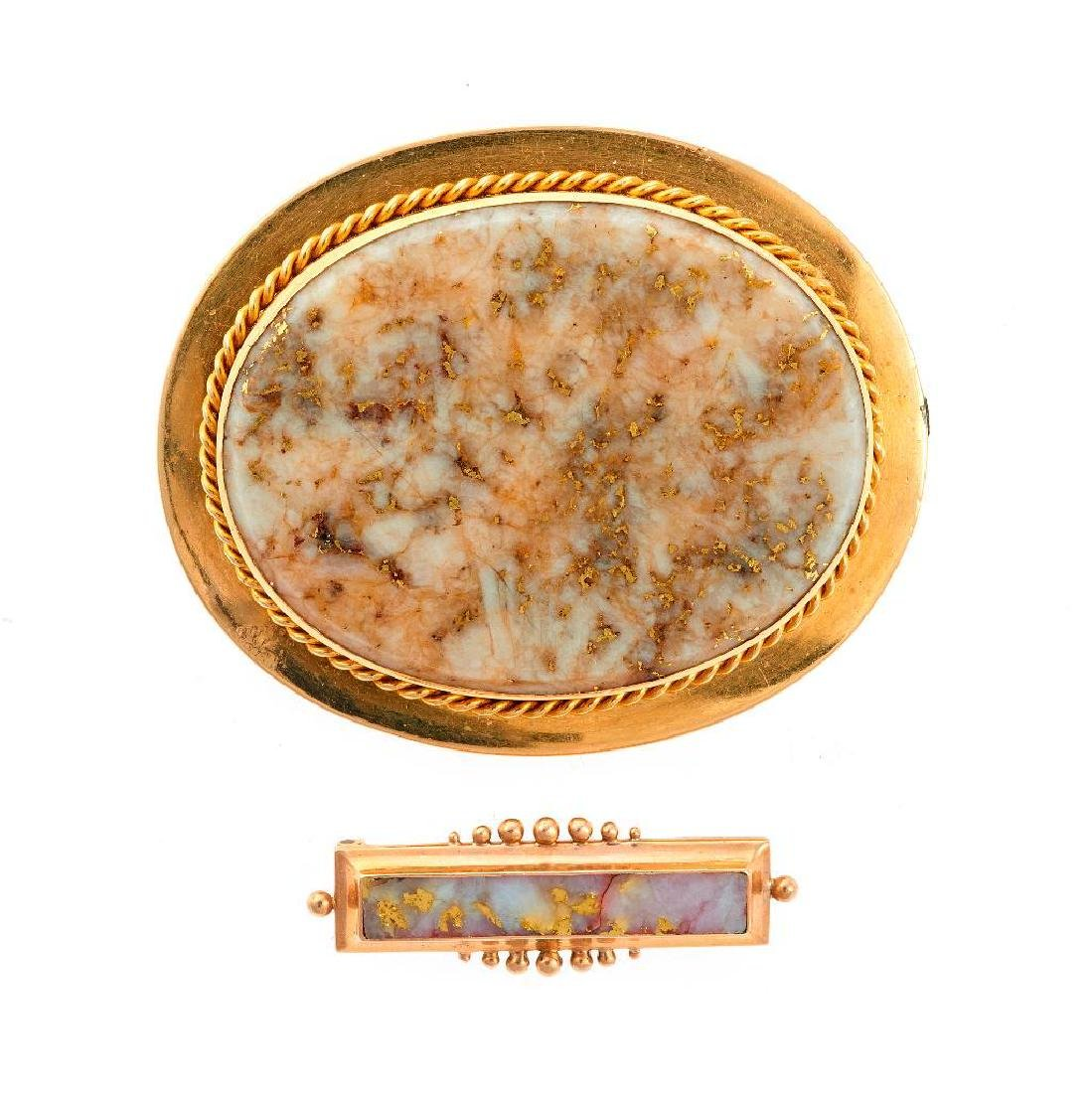 Two gold-in-quartz and 14k gold brooches