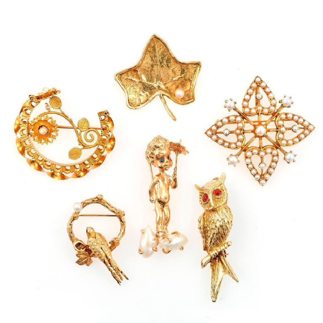 Collection of 6 pearl and 14k gold brooches