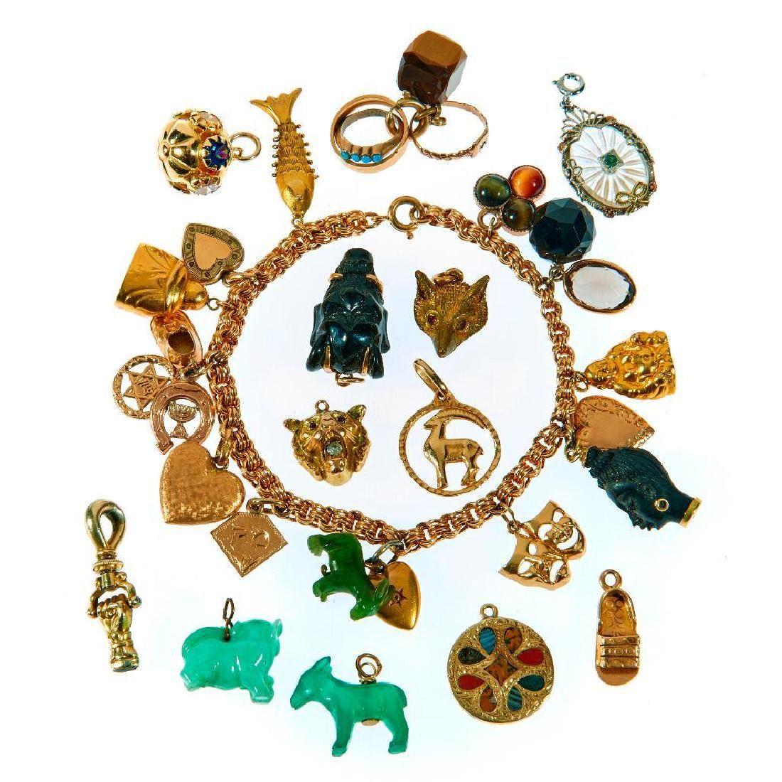 18k Gold bracelet with charms