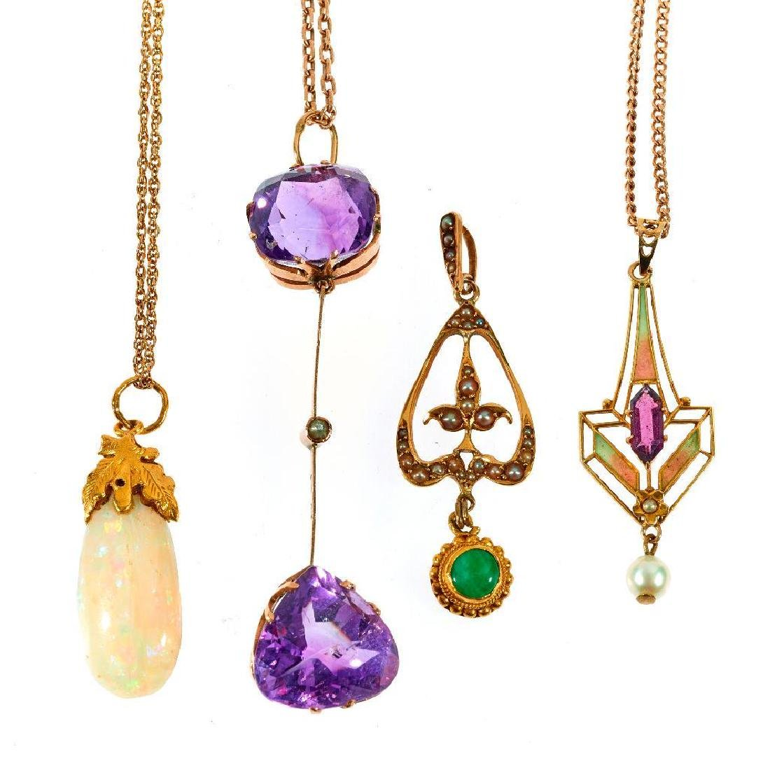 Collection of 4 Art Nouveau pendant and chains