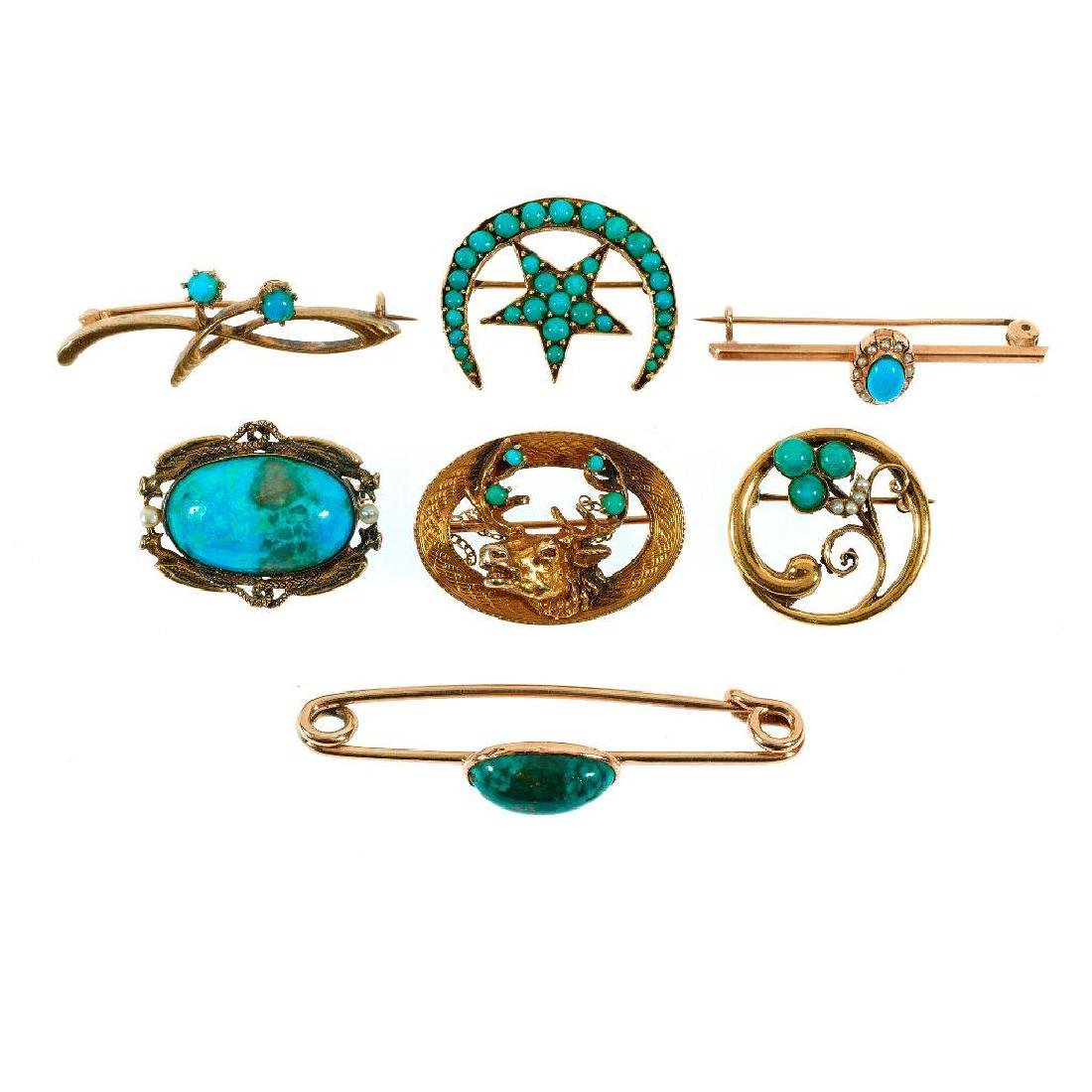 Collection of 7 turquoise and 14k gold brooches