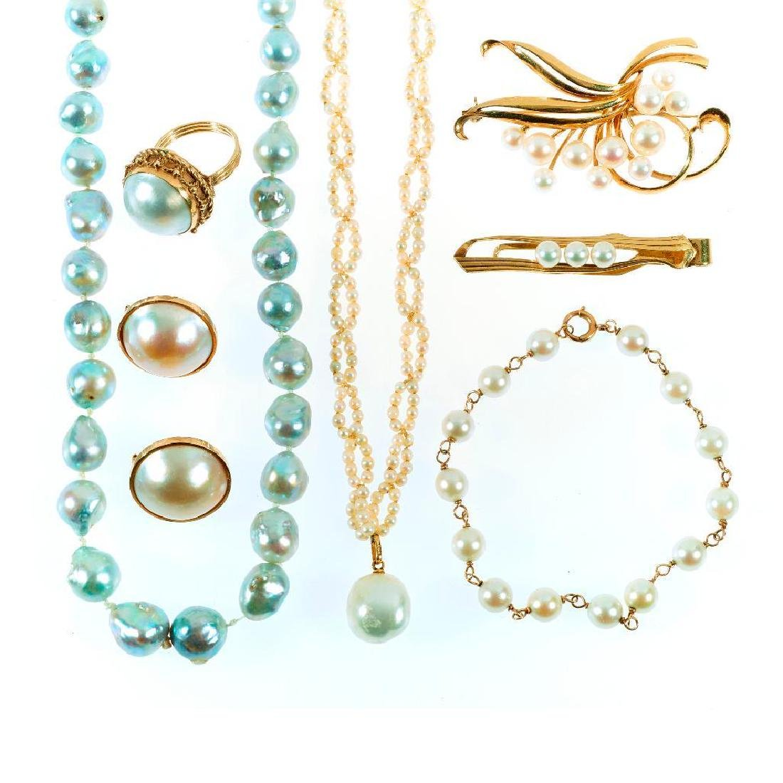 Collection of pearl jewelry, including Mikimoto