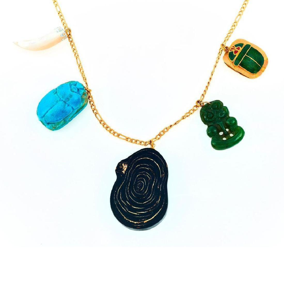 18k Gold and assorted stone charm necklace