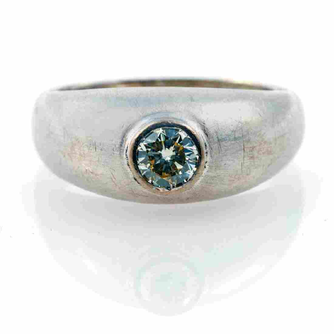 Diamond and 18k white gold solitaire ring