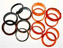 Collection of 14 bakelite, resin and plastic bangles br